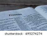 Small photo of proverbs in english and spanish