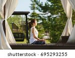 young girl doing yoga or... | Shutterstock . vector #695293255