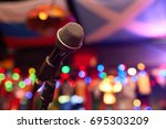 microphone in concert hall   Shutterstock . vector #695303209