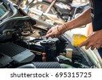 engine engineer is replacing ...   Shutterstock . vector #695315725