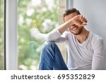 smiling shy man close face with ... | Shutterstock . vector #695352829