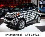 DETROIT - JANUARY 11: A houndstooth Smart car on display at the 2011 North American International Auto Show Press Preview on January 11, 2011 in Detroit, Michigan. - stock photo