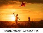 children launch a kite in the... | Shutterstock . vector #695355745