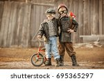 boys in the image of a rider... | Shutterstock . vector #695365297