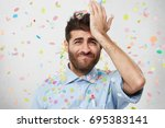 pleasant looking man with beard ... | Shutterstock . vector #695383141