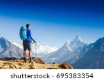 active hiker hiking  enjoying... | Shutterstock . vector #695383354