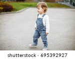 cute baby girl with blonde hair ... | Shutterstock . vector #695392927