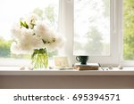 a bright window with flowers  a ... | Shutterstock . vector #695394571