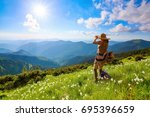 on the lawn in mountains... | Shutterstock . vector #695396659