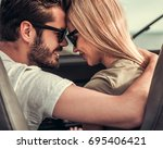beautiful young couple is... | Shutterstock . vector #695406421