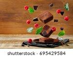 flying chocolate cake brownie... | Shutterstock . vector #695429584