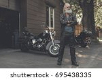 Small photo of Crackerjack old man locating near motorbike