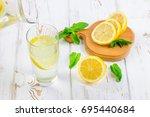 in a glass beaker  a cold... | Shutterstock . vector #695440684