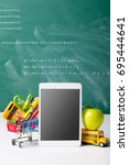 Small photo of Tablet pc, notebook stack and pencils. Schoolchild and student studies accessories. Back to school concept.