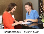patient being attended by a... | Shutterstock . vector #695445634