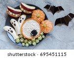 healthy fruit halloween treats. ... | Shutterstock . vector #695451115