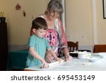 little boy and his grandmother... | Shutterstock . vector #695453149