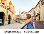 kid tourist admiring arena and... | Shutterstock . vector #695462185