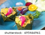 steamed fish with curry paste... | Shutterstock . vector #695466961