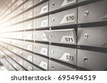 mail boxes filled of leaflets... | Shutterstock . vector #695494519