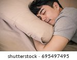young asian man with attractive ... | Shutterstock . vector #695497495