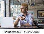 online shopping. man holding a... | Shutterstock . vector #695499001