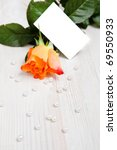 Beautiful rose with pearls as a gift for Valentine's day with copy-space card. - stock photo