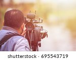 cameraman using black... | Shutterstock . vector #695543719