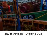 Small photo of The amidships of two docked fishing boats in a small Scottish fishing town.