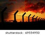 Sunset Behind Fence