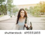 young asia woman at sunset... | Shutterstock . vector #695551855