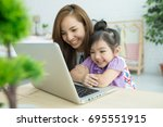 beautiful asian girl and mother ... | Shutterstock . vector #695551915