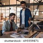 attractive businessmen in... | Shutterstock . vector #695559871
