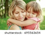 happy parent mother with child... | Shutterstock . vector #695563654