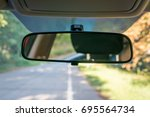 vehicle interior with rear view ... | Shutterstock . vector #695564734