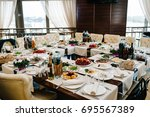 served table with food. plates...   Shutterstock . vector #695567389