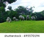 sheep statue on green hill | Shutterstock . vector #695570194