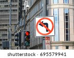 no left turn sign on the street | Shutterstock . vector #695579941
