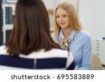 stylish businesswoman chatting... | Shutterstock . vector #695583889