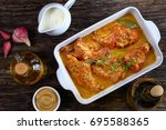 appetizing rabbit cooked with... | Shutterstock . vector #695588365