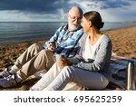 affectionate senior couple... | Shutterstock . vector #695625259