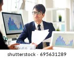 young economist talking to... | Shutterstock . vector #695631289