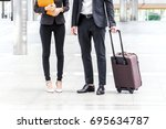 business people with luggage in ... | Shutterstock . vector #695634787