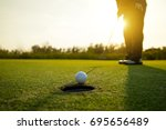 golfer putt ball to hole on... | Shutterstock . vector #695656489