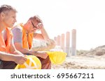 tired supervisor sitting with... | Shutterstock . vector #695667211