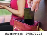 pickpocket thief is stealing...   Shutterstock . vector #695671225