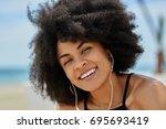 happy afro american woman...   Shutterstock . vector #695693419