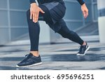 sporty male is stretching his... | Shutterstock . vector #695696251