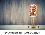 Stock photo retro golden classic microphone on table vintage old instagram style filtered photo 695705824