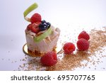 fruit cake and red berries | Shutterstock . vector #695707765